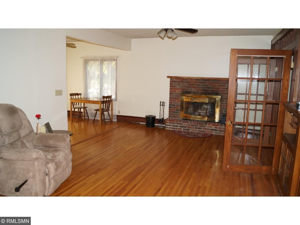 The dining room is spacious, has hardwood flooring, and French doors which open to the living room.