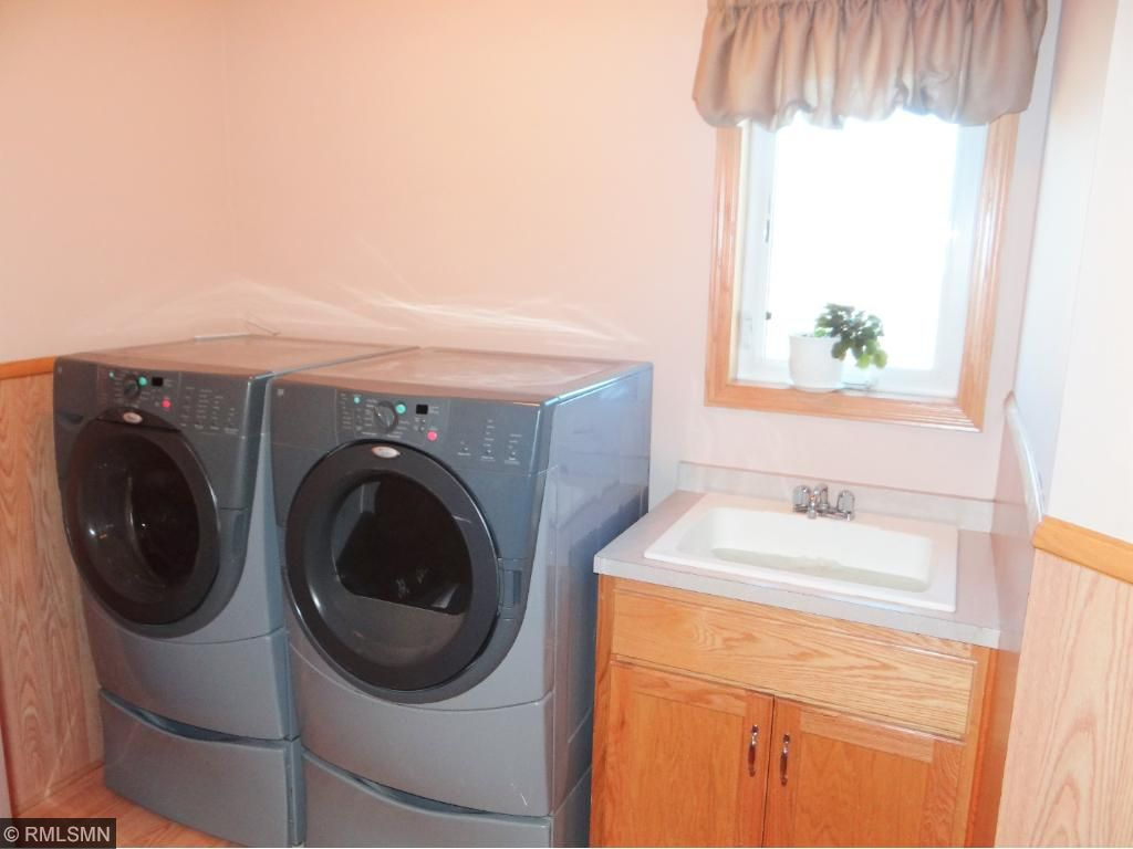 Laundry on lower level with a tub.