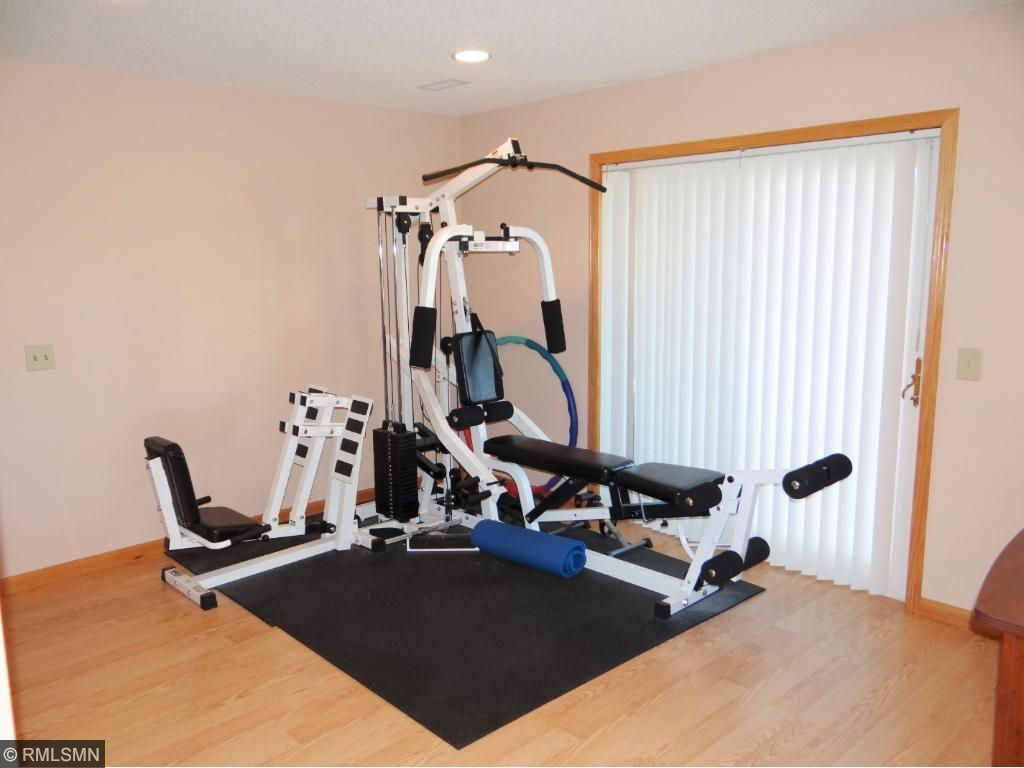 Lower Level Family room is used as a Gym. Walk out to the Patio