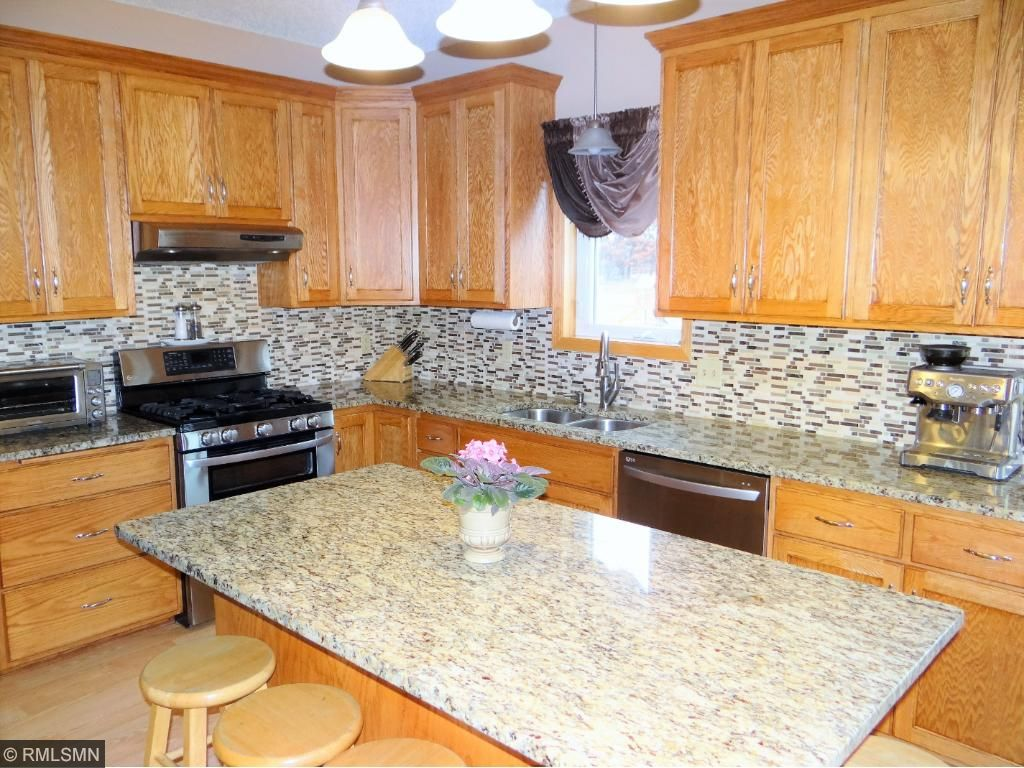 Large Kitchen with Lots of Cabinetry, SS Appliances, Granite Counter Top.