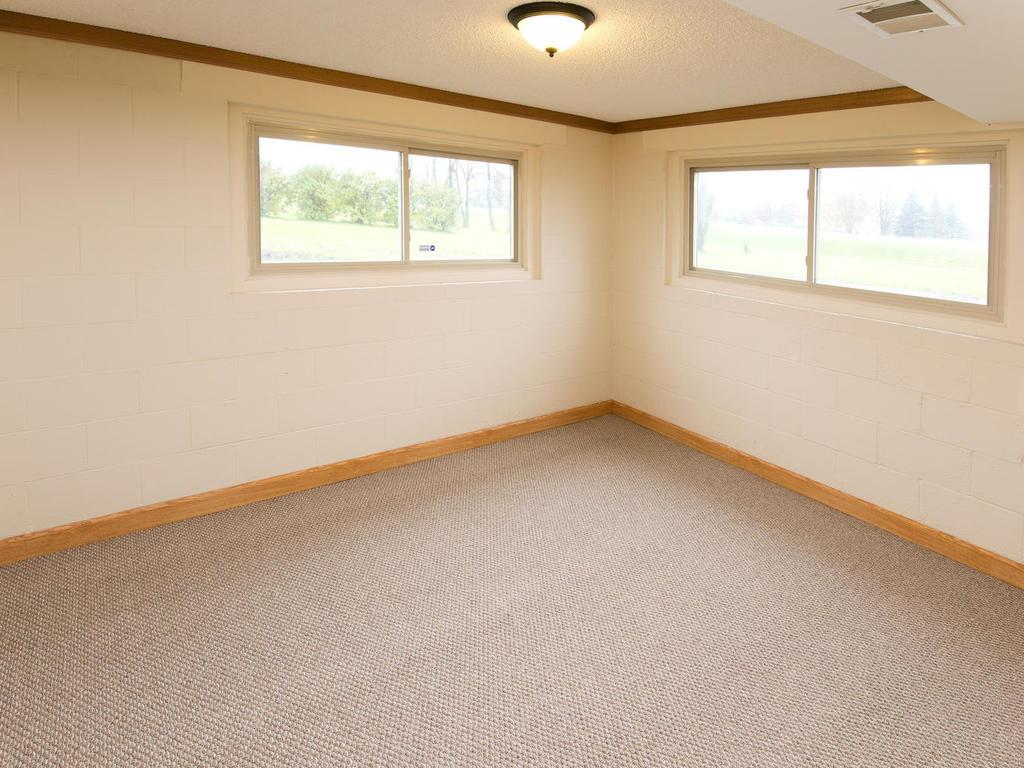 This large corner room in the lower level has two big windows allowing not only lots of natural light but also views of the outdoors.