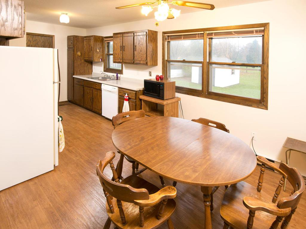 A convenient eat-in kitchen and dining area with a large window providing pleasant views.