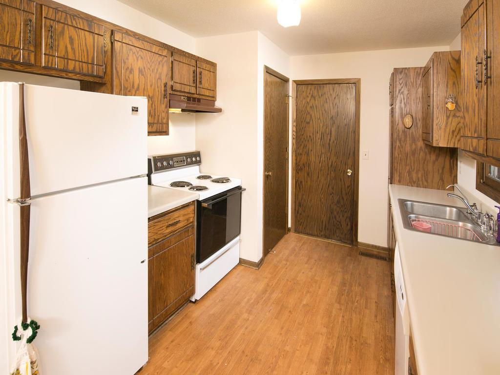 The kitchen has a convenient direct access to the oversized, heated garage.