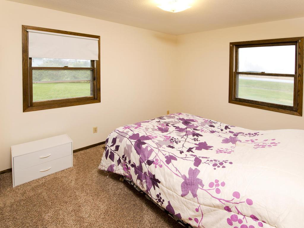 This third bedroom on the main level also has natural light and pleasant views from two windows.