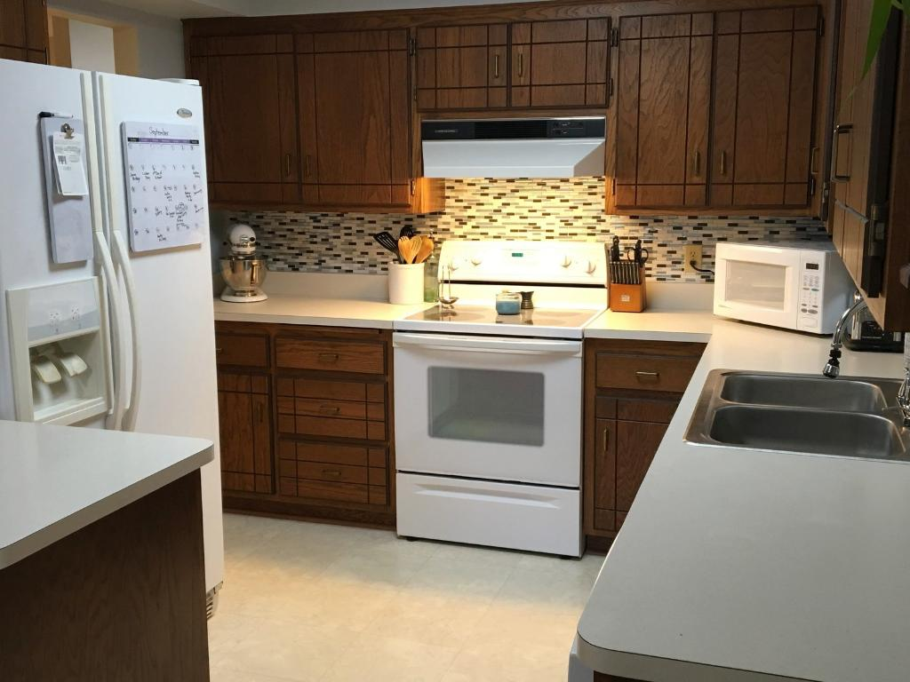 Nice, workable kitchen with plenty of counter space and storage.