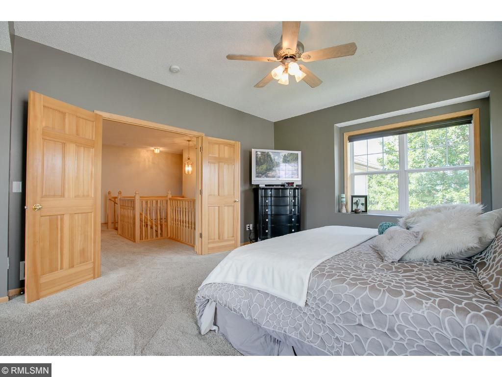 French doors lead to a master suite fit for a king and queen!