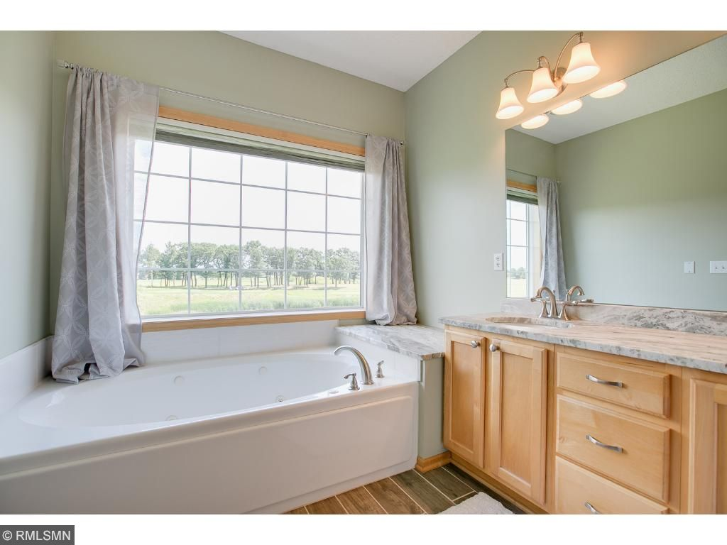 All new master suite featuring a separate soaking tub, deal sinks with marble vanity and custom tiled, walk-in shower. This is a must see.