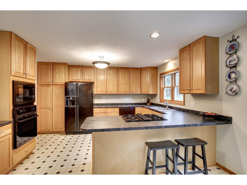 Updated kitchen with custom cabinets and newer appliances.
