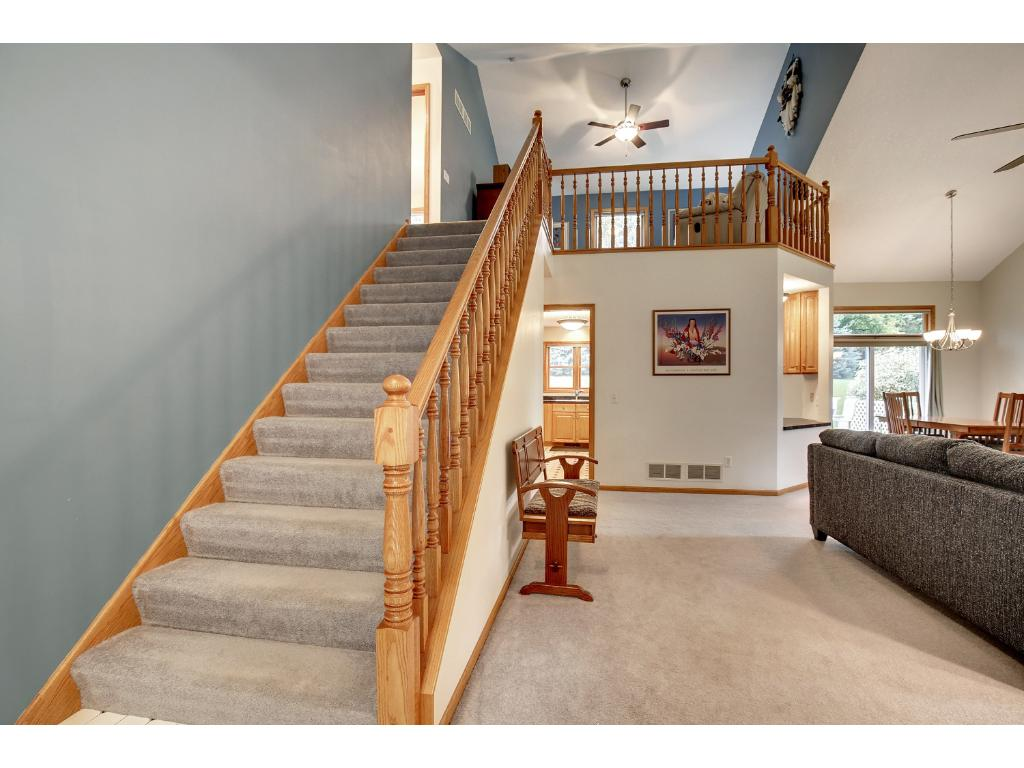 Extra wide stair case with upper lvl loft