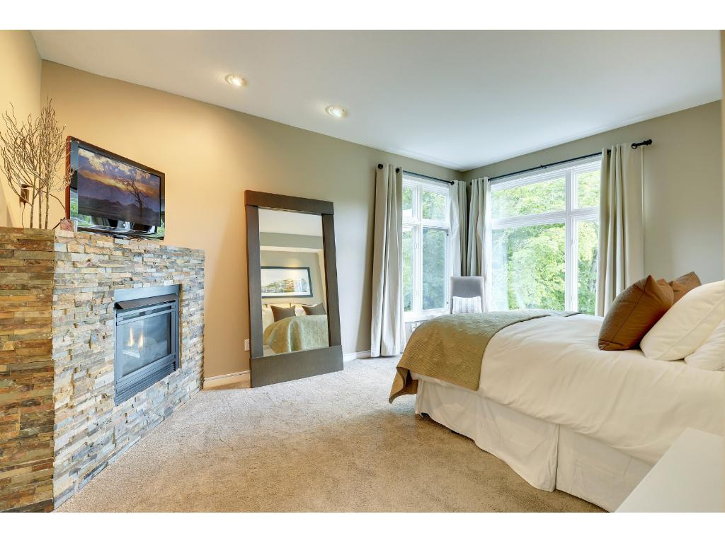 The main floor master bedroom suite is very well appointed. It features views of the valley, a gas fireplace, a luxurious master bath and walk-in closet.