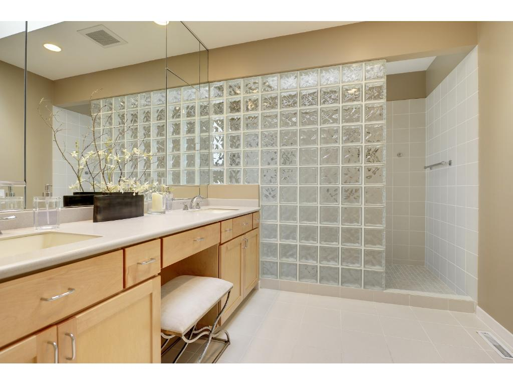 The master bath with glass block shower, double sinks and a separate water closet.