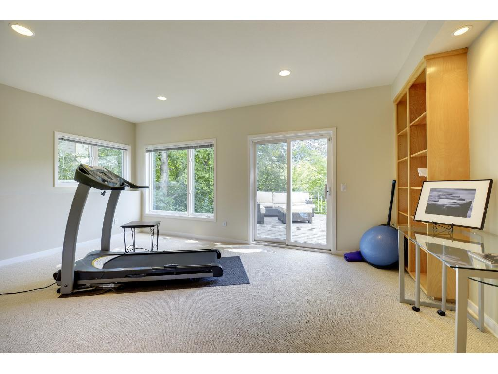 An exercise room! This area could also serve as a perfect guest suite with access to an adjoining bedroom and a convenient 3/4 bath just steps away.