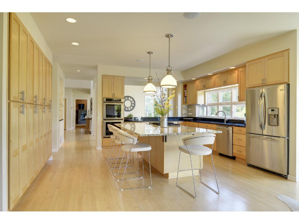 A chef's delight! Imagine preparing meals in this expansive kitchen. Plenty of room for family and friends.