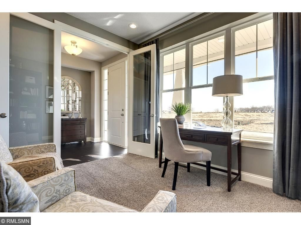 Main floor study with gorgeous 8ft tall French doors.  Photo of like home.