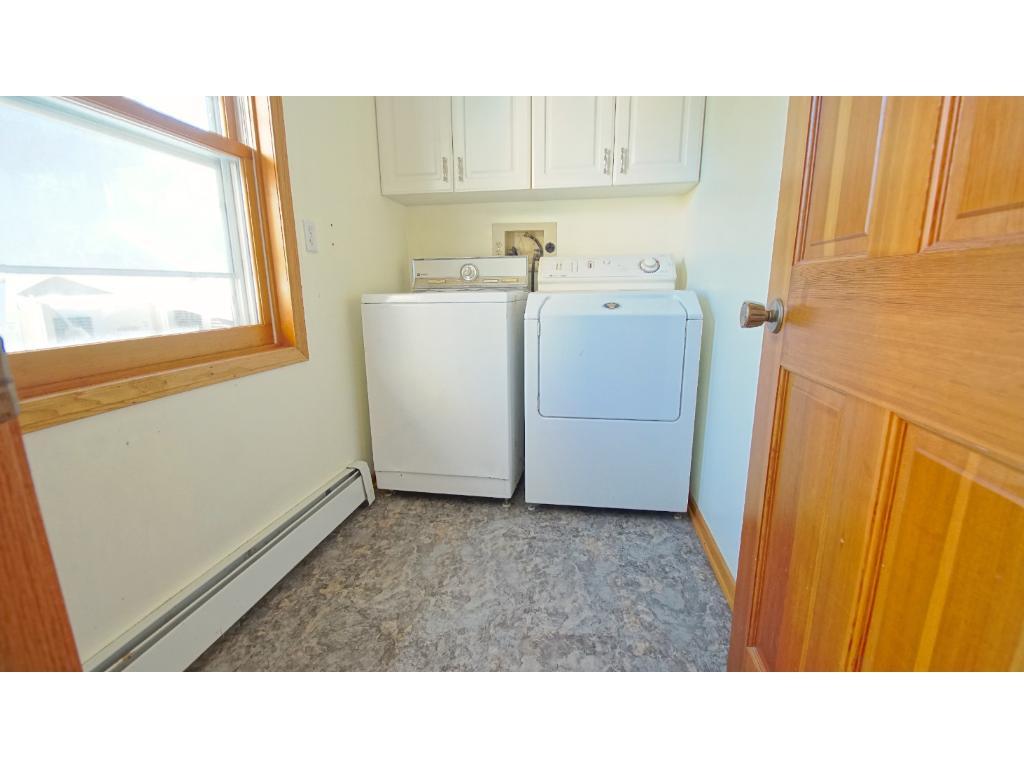 Laundry Room inside back entrance.  New Floor!