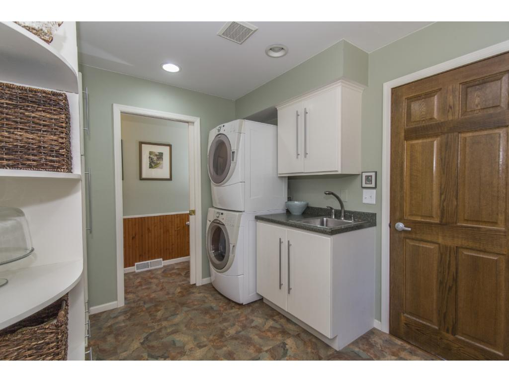 Completely updated laundry/mud room with lots of storage.