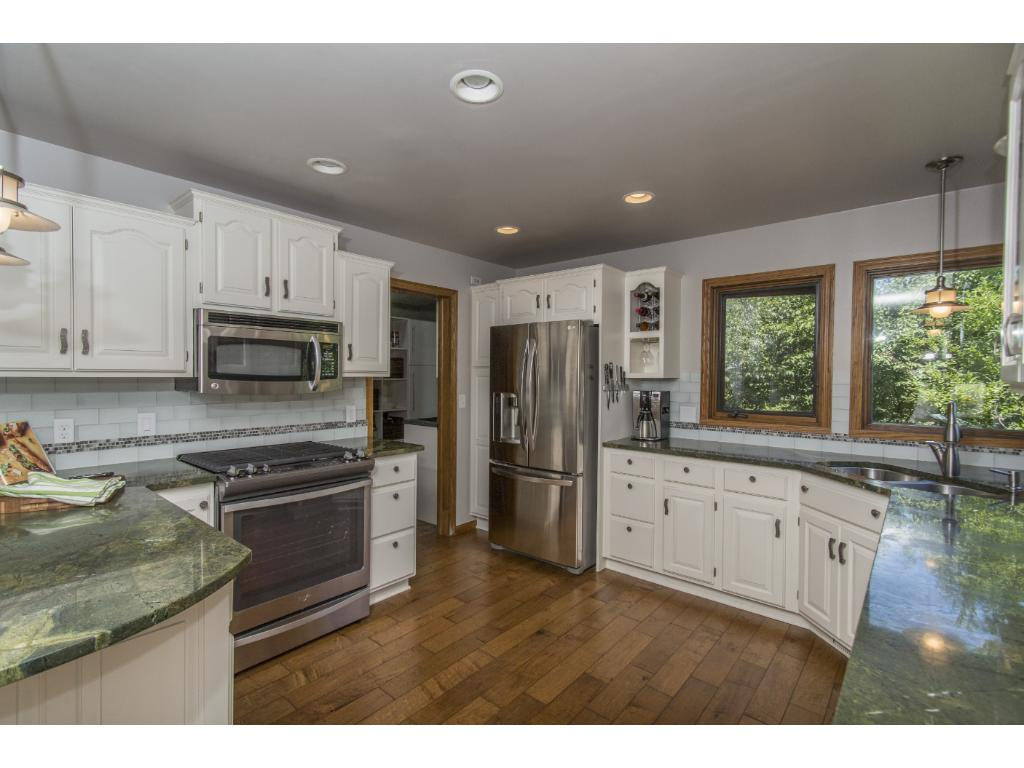 Updated kitchen beautiful!  Stainless steel appliances, lots of cabinets for storage, dining area, windows overlooking the lake!