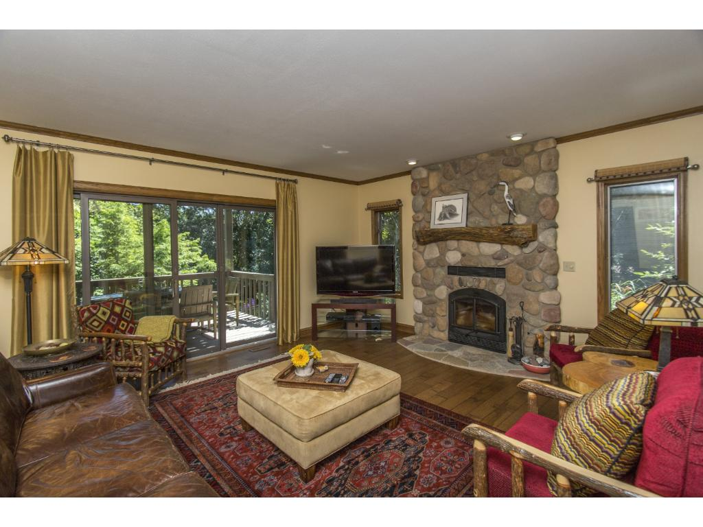 Can't you image the cozy winter nights spent in this family room?  Lots of windows and a slider let in natural light, as well as easy access to another deck overlooking the lake.