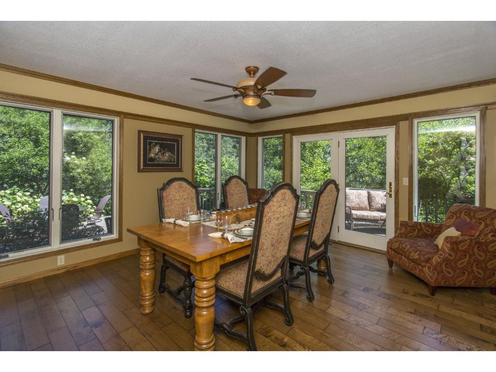 Light and bright dining area - with windows, slider and deck overlooking Lake Mallalieu!