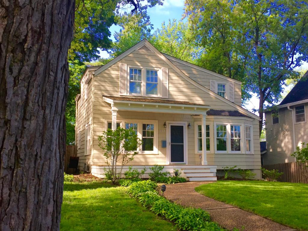 Welcome to 112 3rd Street! This property has wonderful curb appeal and features a new front porch, newer landscaping, and even a glimpse of Lake Minnetonka from the front yard.