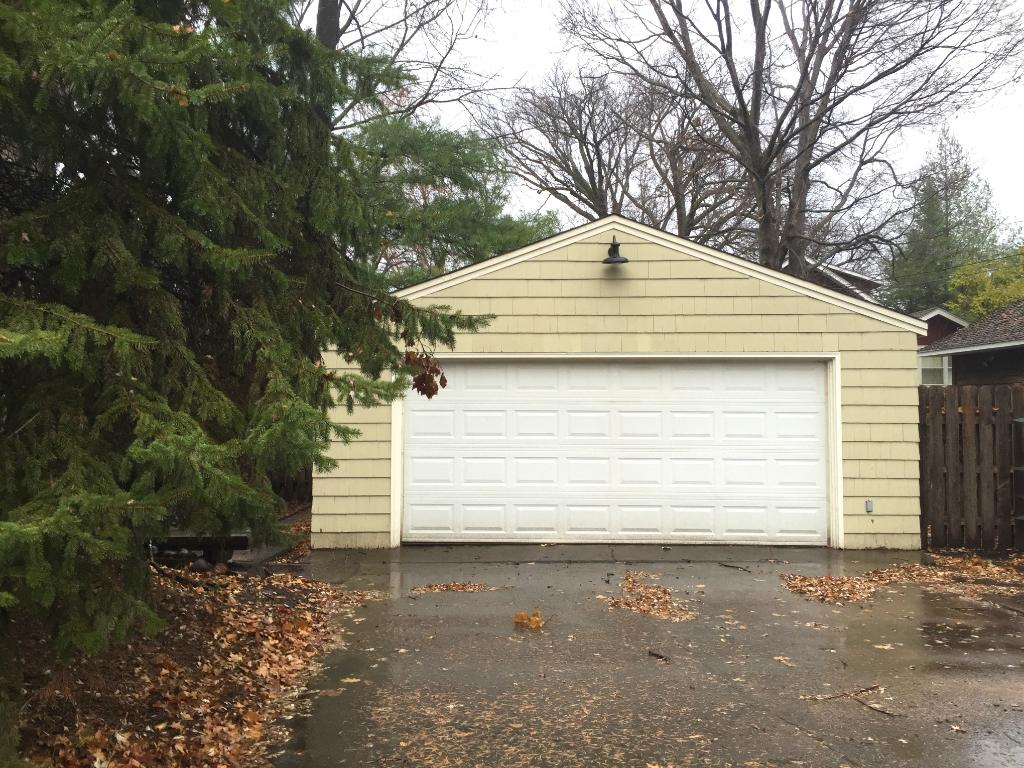 The 2 car detached garage fronts onto Maple street.