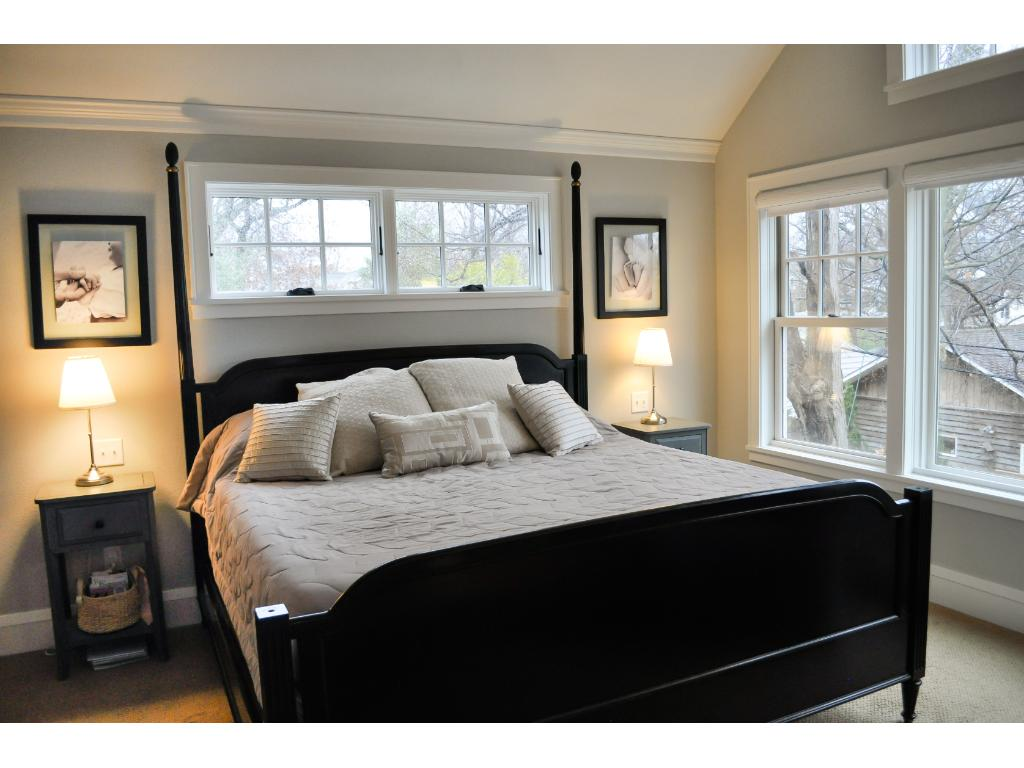 The master suite is part of the addition done in 2013 and features a vaulted ceiling, 2 walk-in closets, and flat screen TV.