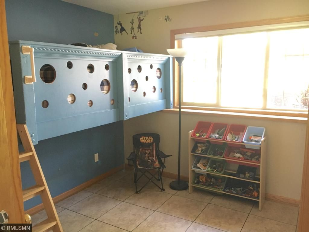 Second lower level room den/bedroom (no closet), features a fun lofted bed!