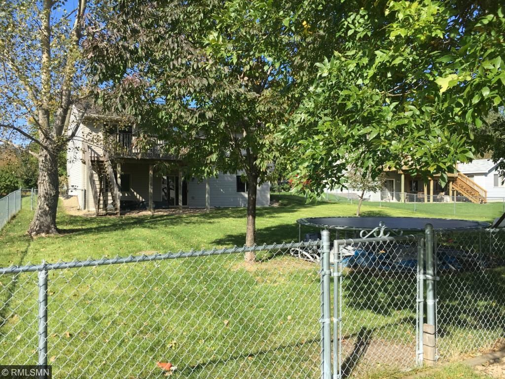 Large fenced yard is private, moderately shaded, and yet inviting to welcome your neighbors by for a visit!