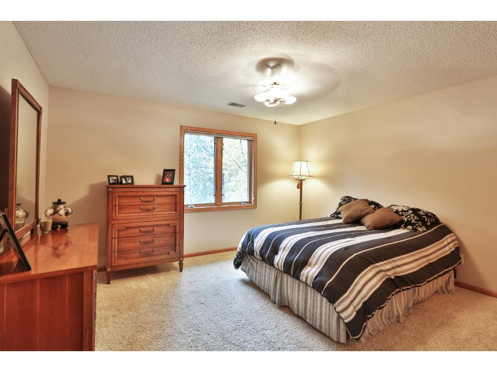 The large second bedroom on the upper level has a ceiling fan and double closet.
