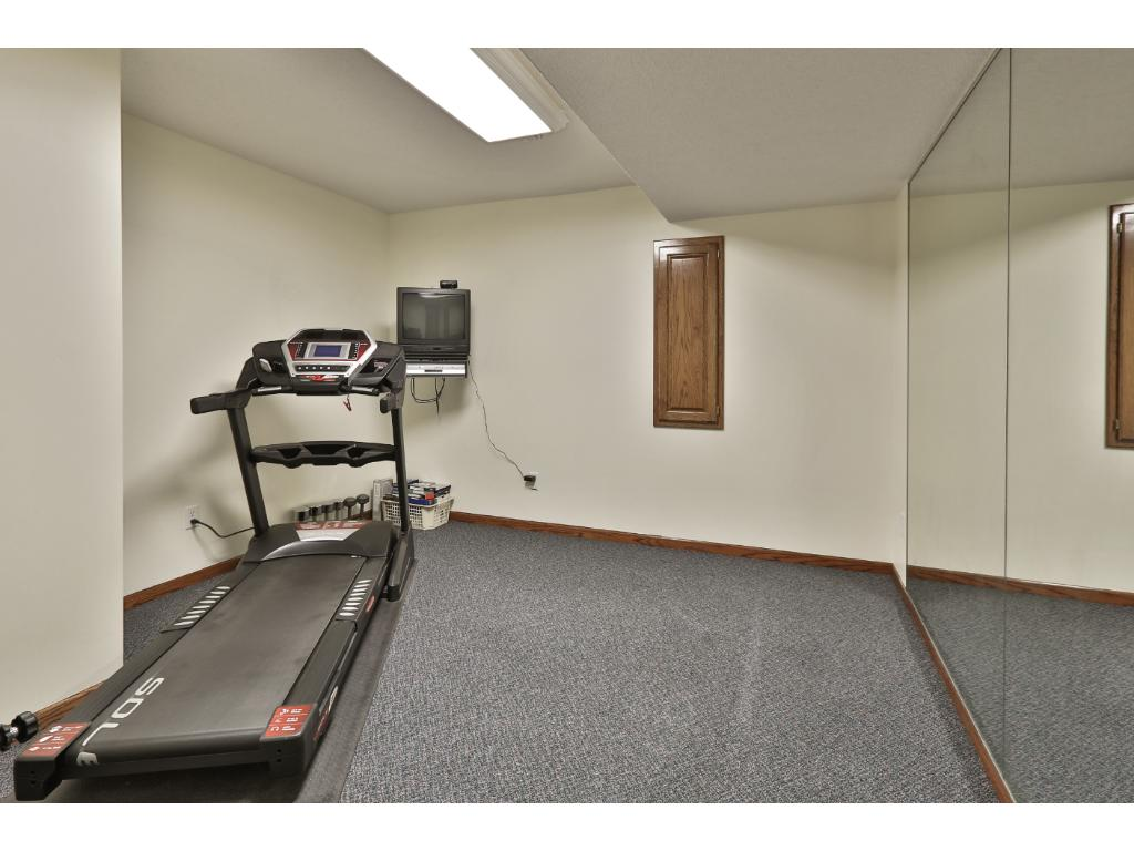 The exercise room can also be used for crafts, a workshop, storage, etc.  An egress window could be added for a 5th bedroom.