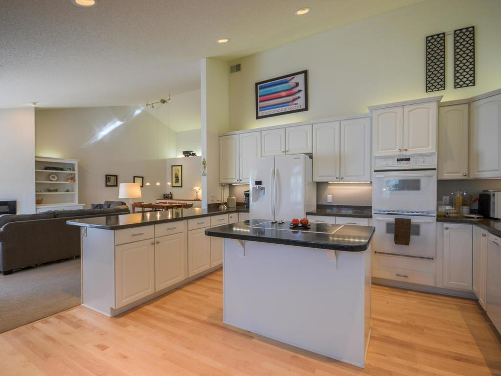 Kitchen with a convenient center isle for preparing meals.   Double ovens. Side x side refrigerator.