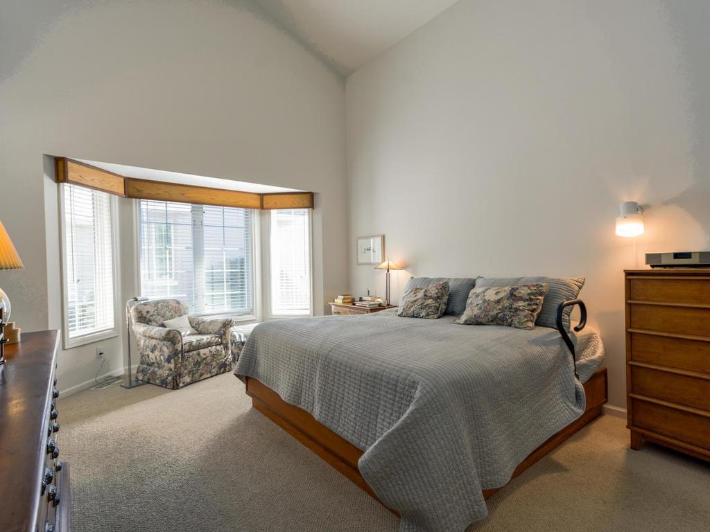 Main floor master bedroom suite.