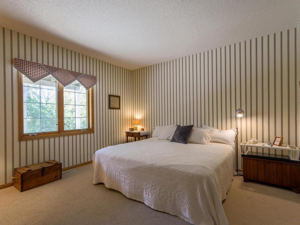 Spacious lower level bedroom.