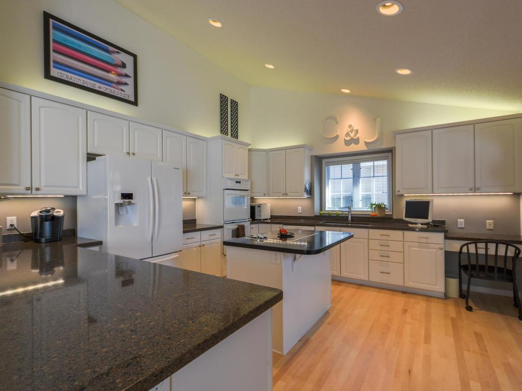 Spacious kitchen with granite counters and high-end appliances.