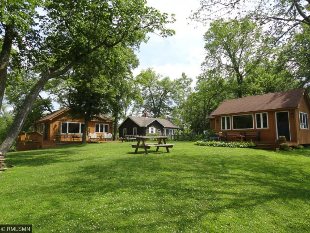 Great lot with tons of open yard space - nice shade trees & grass.