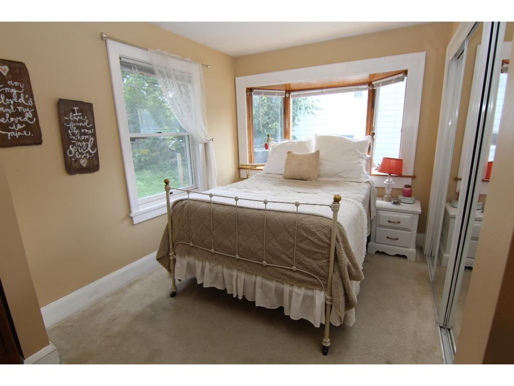 Just one half of the large master bedroom, with large closet and a sunny bay window.