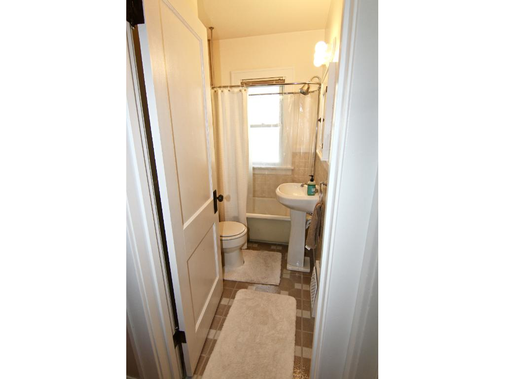 Main level bathroom with original, deep soaking tub.