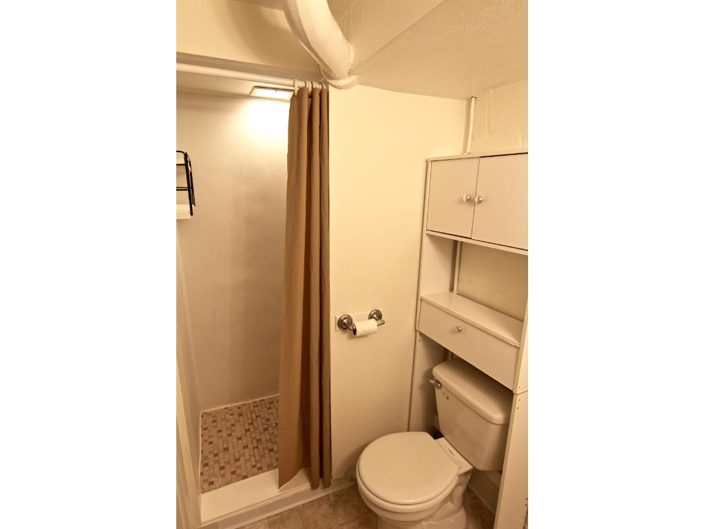 Lower level 3/4 bath, adjacent to family room & finished laundry room.