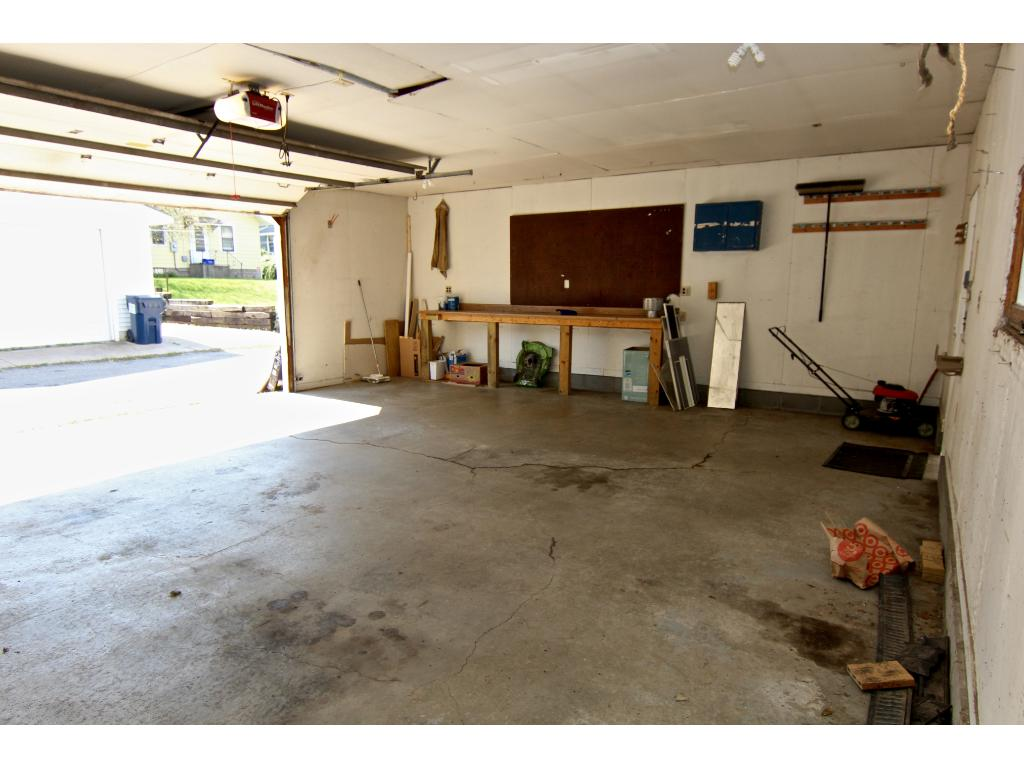 Garage has a workbench & separate electrical panel.