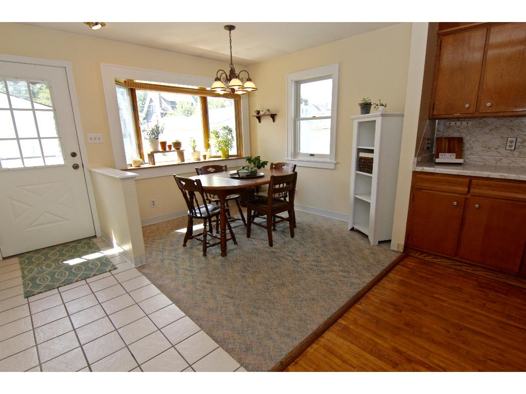 Informal dining room off kitchen. The south face give the space lots of light. Door leads to the backyard.