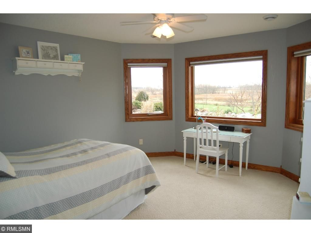 This is a lower level bedroom! Hard to tell by all the natural light coming through the windows!
