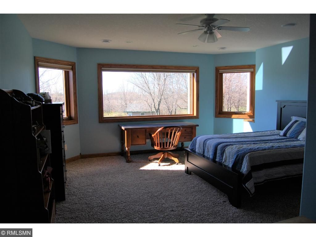 Another spacious lower level bedroom with large windows!