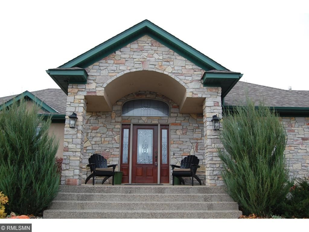 The beautiful stone archway above the front porch makes a statement as you approach the home