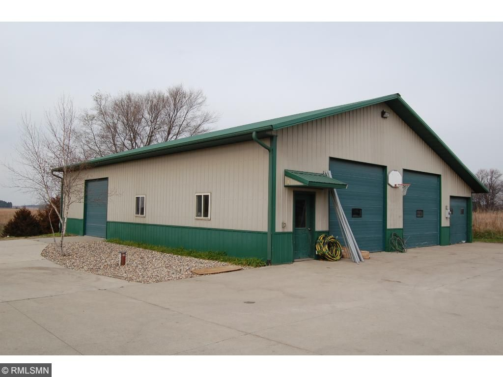 The 34x34 2 stall garage is insulated, finished, has in-floor heat, and additional storage
