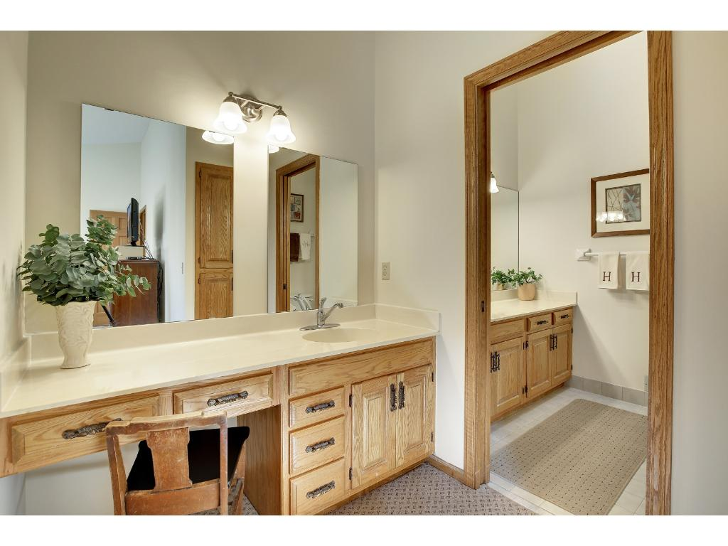Private master vanity with sink and master 3/4 bathroom also has another sink.