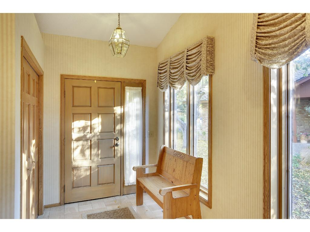 Inviting front entry with room to take off your shoes and stay a while.