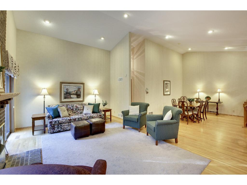 Vaulted ceilings and hardwood floors are featured in this beautiful home