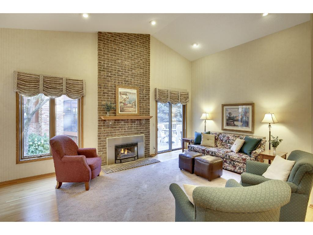 Great entertaining spaces on main level with open concept and brick fireplace