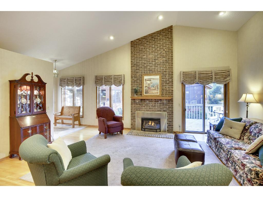 Living room with plenty of seating room, a gas fireplace and access to the deck