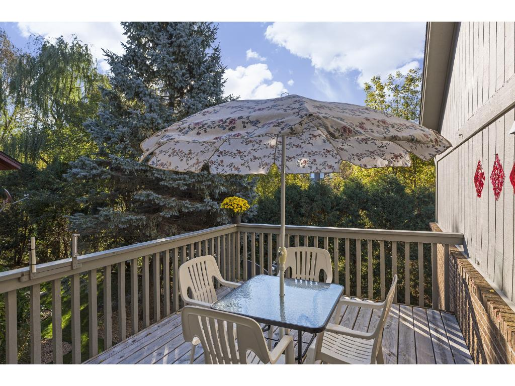 Spacious deck with nature views is a great spot for bird watching or enjoying a quiet meal